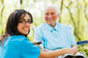 smiling old caregiver and elderly woman